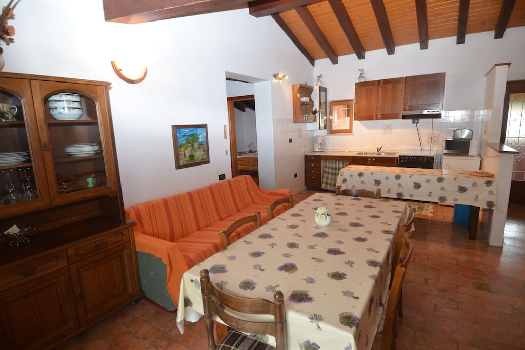 The living room and the kitchen are located in the same room, with an additional bed for two persons