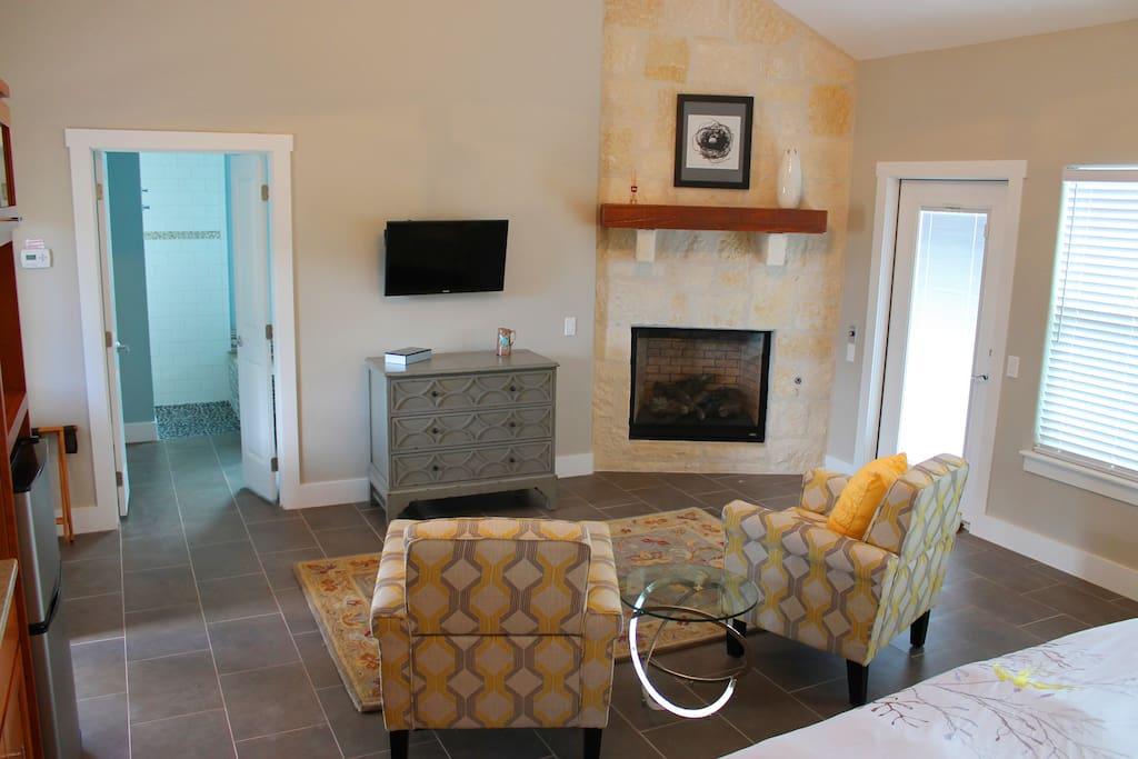 Seating area with gas fireplace and TV