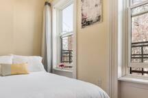 Quiet, cozy and bright smaller rear bedroom.