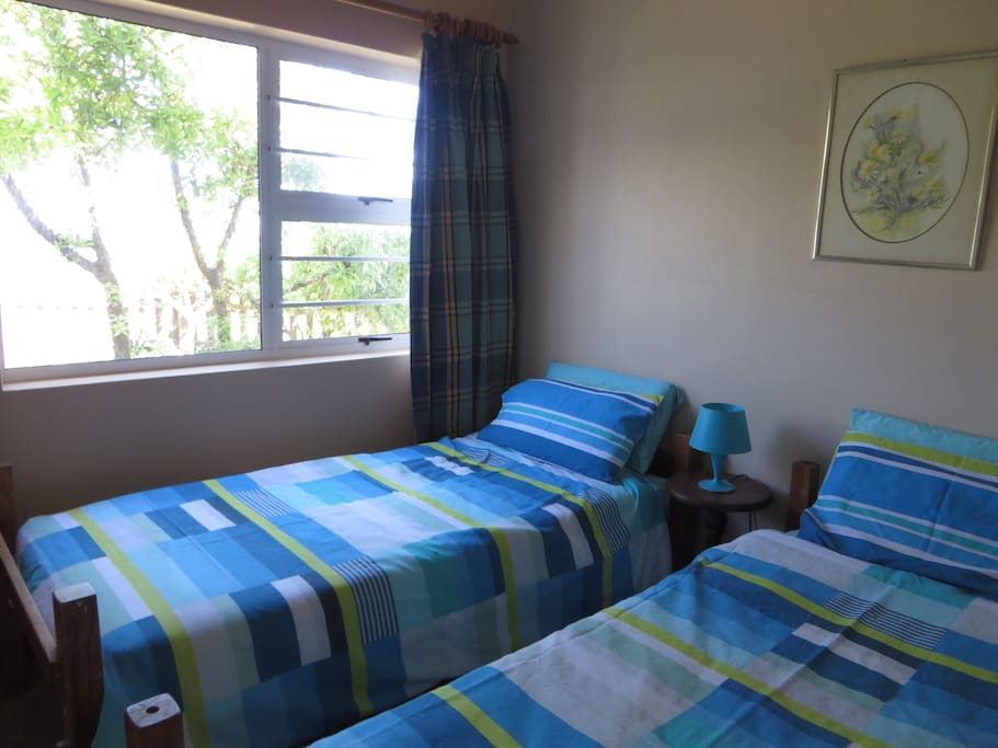 Twin bedroom at front of house with a stunning sea-view.