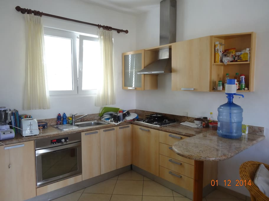 All dishes and oven, mix a few drinks, blender toaster and microwave