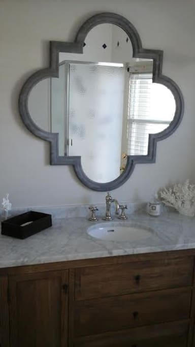 Large, bright bathroom with marble counters