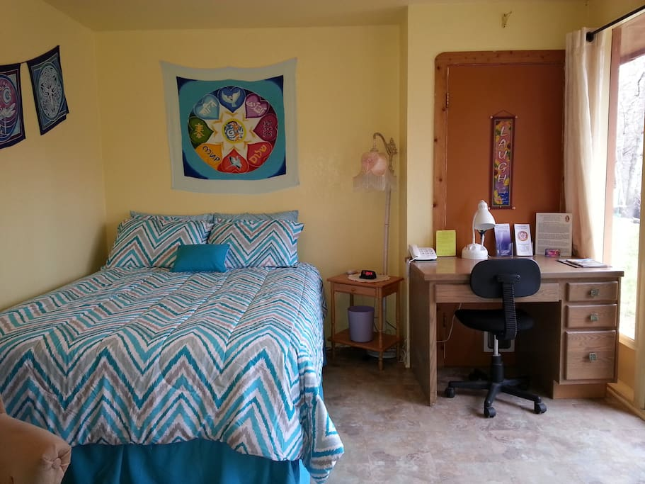 Queen size comfortable bed and desk with view!