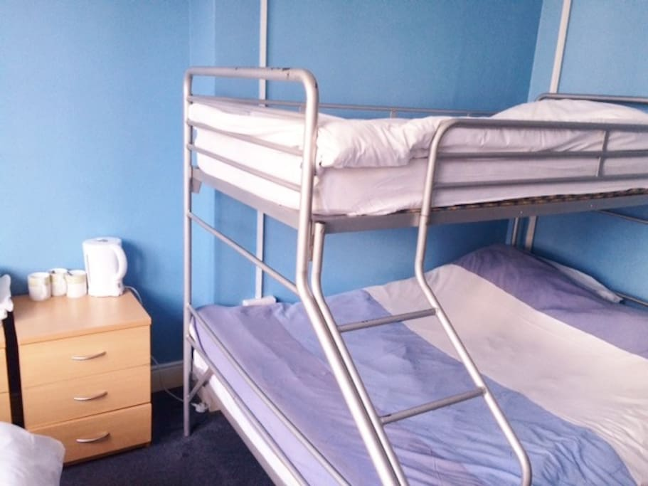 Room can sleep 4 people. There is one separate single bed, and then one bunk bed with a double bed on the bottom and a single bed on top.