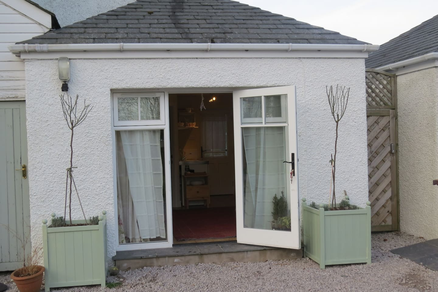 the exterior of the Little Garden House - the roses will look much nicer in the summer!