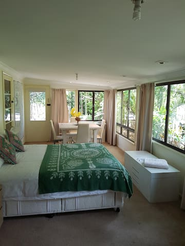 Main bedroom with queen sized bed and lovely private garden outlook