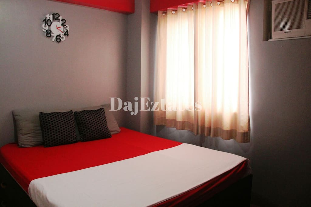 1 bedroom unit with customized queen sized bed and aircon