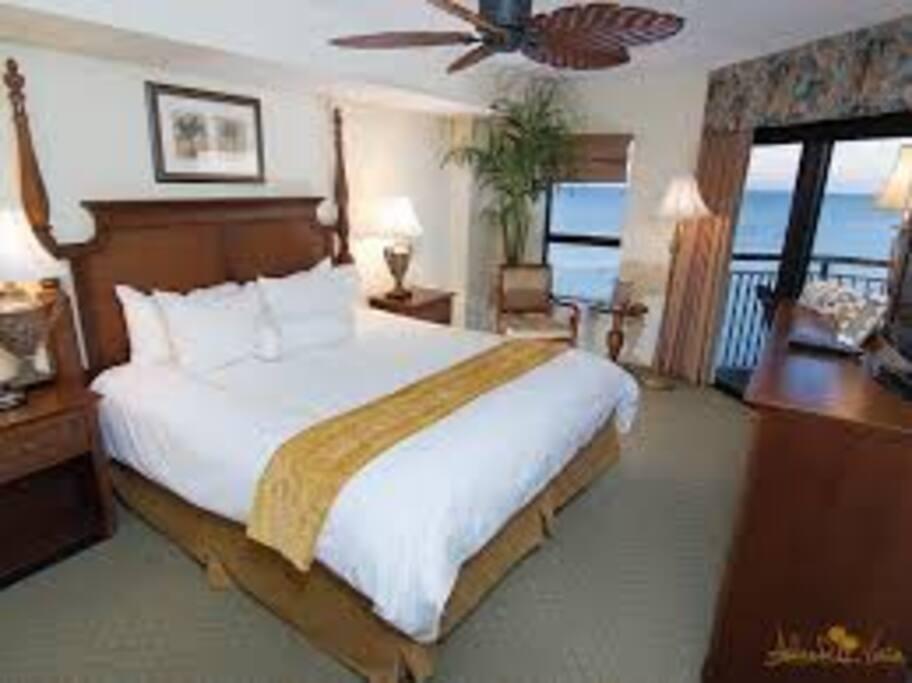 Master bedroom overlooking the ocean with patio door to oversized balcony