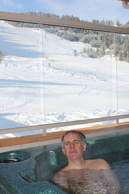 Watch the skiers while enjoying a soak.