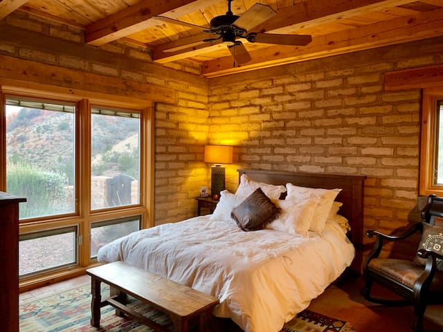Master bedroom with Queen bed and south/southwest view of Davis Mountains