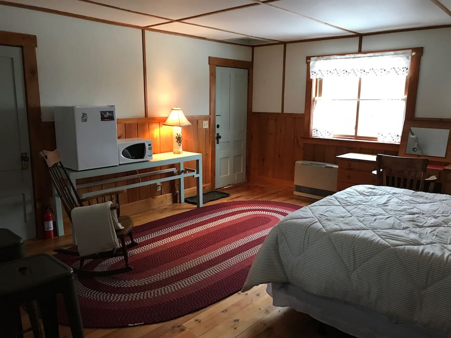 The apartment has views of Cottrill's Cove along the Damariscotta River. Renters control the heat in the studio with a Rinnai heater. There is a mini-fridge, microwave, and closet space.