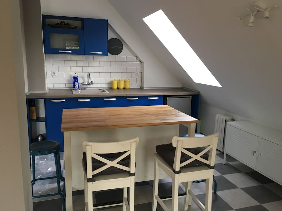 An acquired taste: the blue kitchen within open plan living area is equipped with fridge, cooker, toaster, kettle, Italian percolator, espresso machine, sugar, coffee and tea;