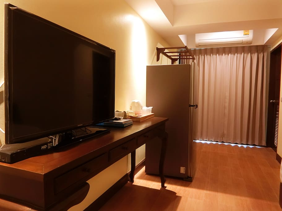 In-room facilities, King-sized bed, TV, Table, Refrigerator, Cloth Rack, Dressing Table, Chair, Private Bathroom, Bathroom amenities