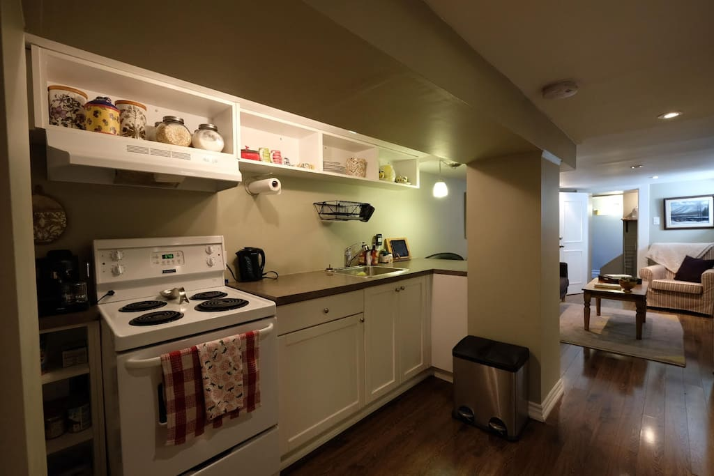 Spacious kitchen supplied with pots, pans and basic cooking necessities