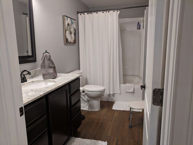 Private full bathroom with tub/shower combo located steps away from the two bedrooms.