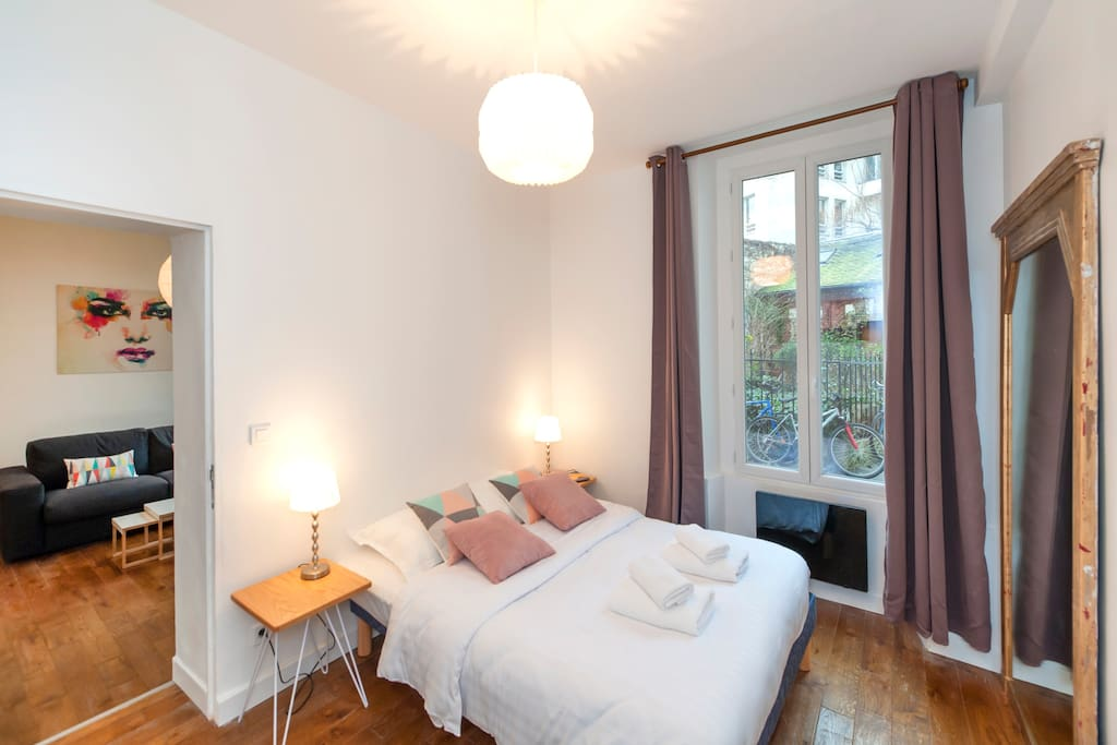 Very nice bedroom with a double bed and a small private shower room. The bedroom offers lot of storage,  2 bedside lamps and an antique large mirror.