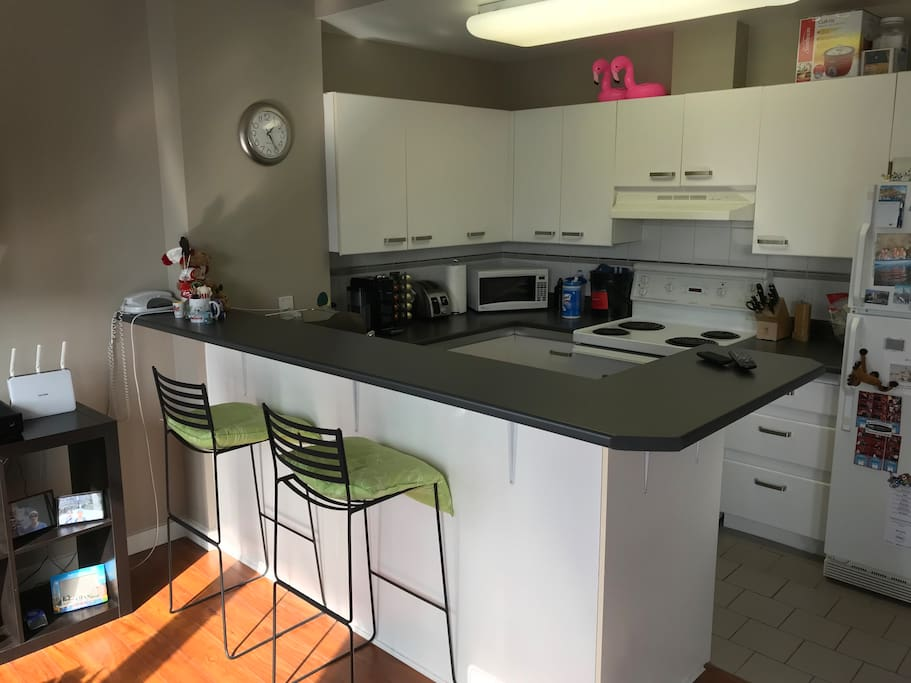 Open plan kitchen that looks onto the lounge so you can watch TV while you cook. The TV also comes with cable TV swivels.