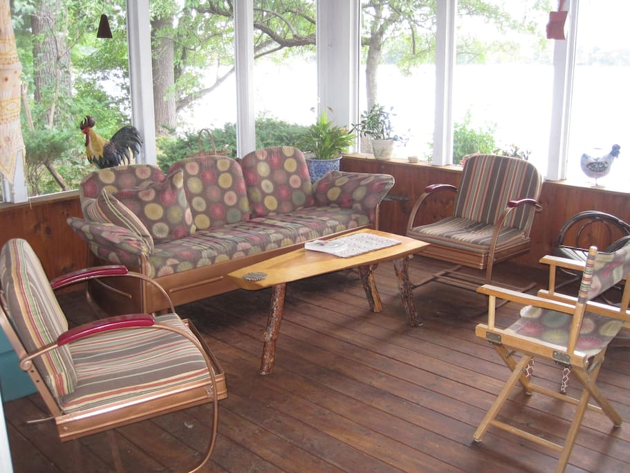 Relax, read, have appetizers on the porch with the lake behind.
