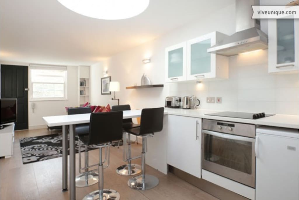Kitchen/dining area with 4 bar stools