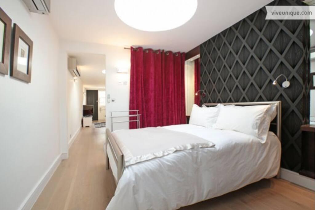 The bedroom looking towards the front door
