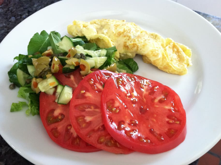 Sample Breakfast dish featuring organic garden tomatoes and greens