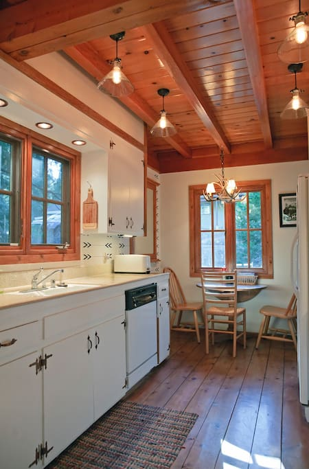 Kitchen with breakfast table and seating for three.