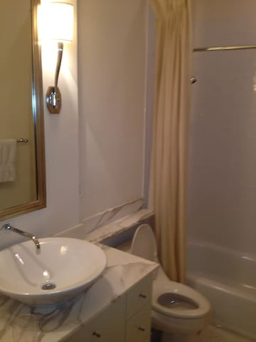 White marble custom bathrooms- private bath for each bedroom