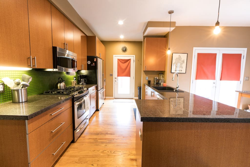 Gorgeous kitchen area, fully stocked with cooking utensils, coffee, etc!