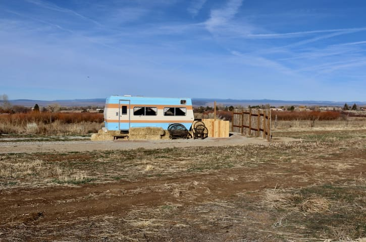 Your own little casita in Arroyo Seco, New Mexico. During your stay, enjoy expansive views from all directions... pasture lands and mountains are seen from close-in and afar.