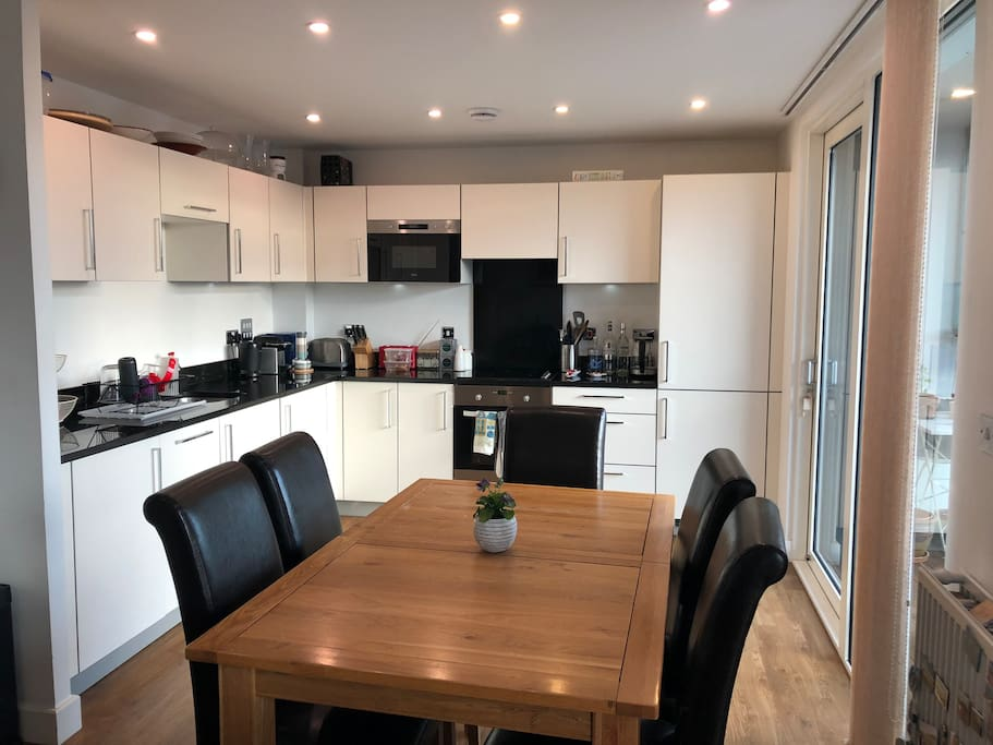 Kitchen and extendable dining table
