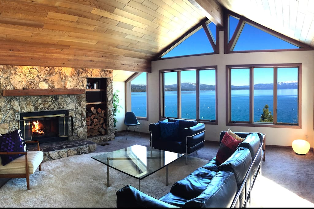 Lakefront panoramic view Living Room with wood burning fireplace.