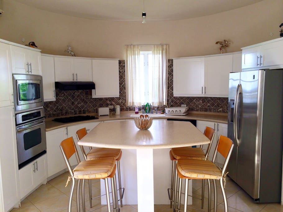 Fully equipped kitchen with new fridge, stove, microwave, oven, toaster, kettle, dishwasher & coffee maker