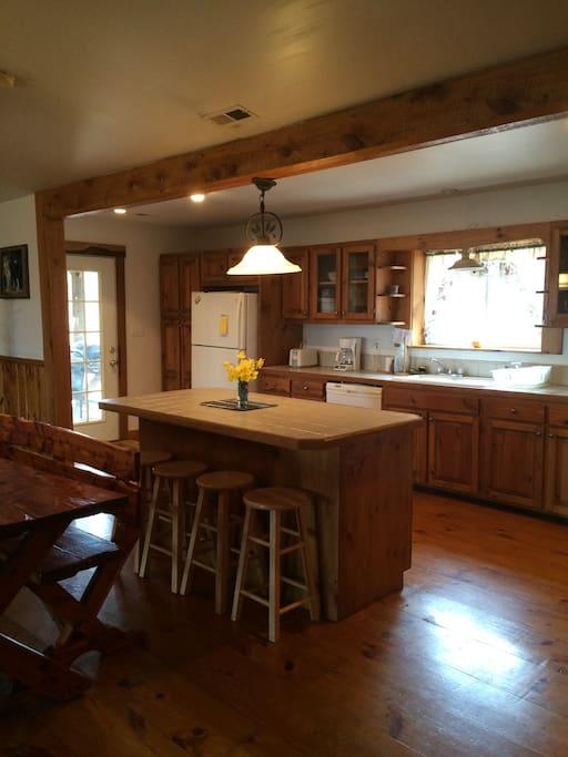 Open kitchen with breakfast island.
