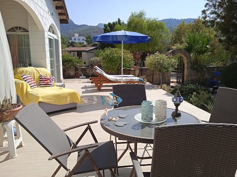 Beautiful bungalow and garden with stunning views