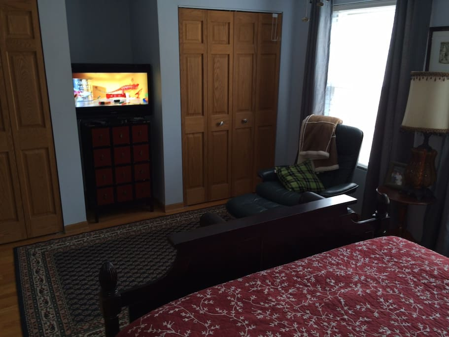 Sitting area in bedroom and private TV
