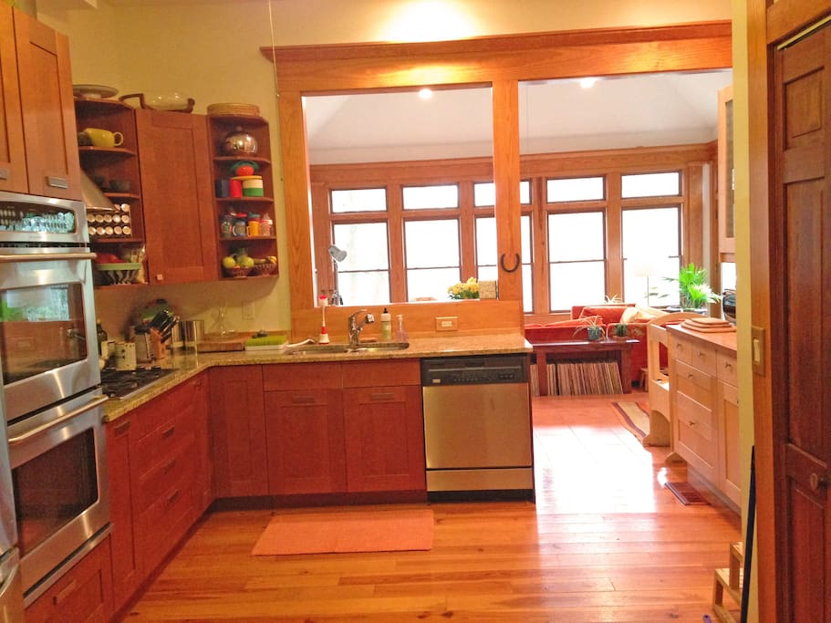 Open kitchen, recently renovated, stocked with supplies by a family that loves to cook.