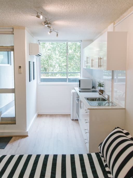 Enjoy the leafy outlook, outside your private balcony, while you cook up a storm in the well appointed kitchen!