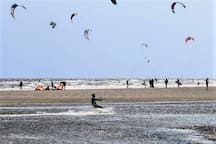 'KiteFEEL' surfschool at beach IJmuiderslag. Lesson 1 (Power kating) basis for all kite related sports. Like Kite surfing, one of many adventurous wind and water sports you can do at our Sea side! You are invited to book private- or group lessons