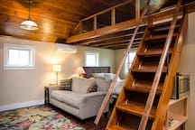 Over your head is 30-year-old, hand-made knotty pine. Under the stairs, you'll find a convenient microwave oven.