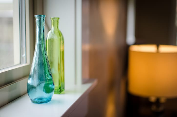 Lots of natural window light and two cute glass bottles. Hey! No stealing the cute glass bottles!