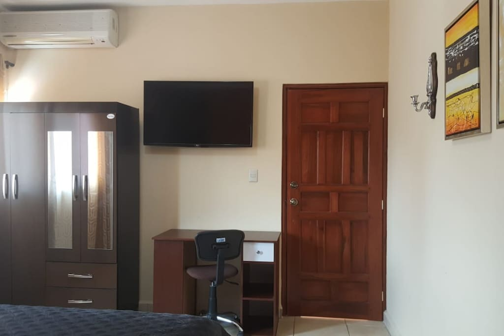 Room contains desk, wardrobe, Cable TV, Air Conditioner, Desk, and Complimentary Wi-Fi