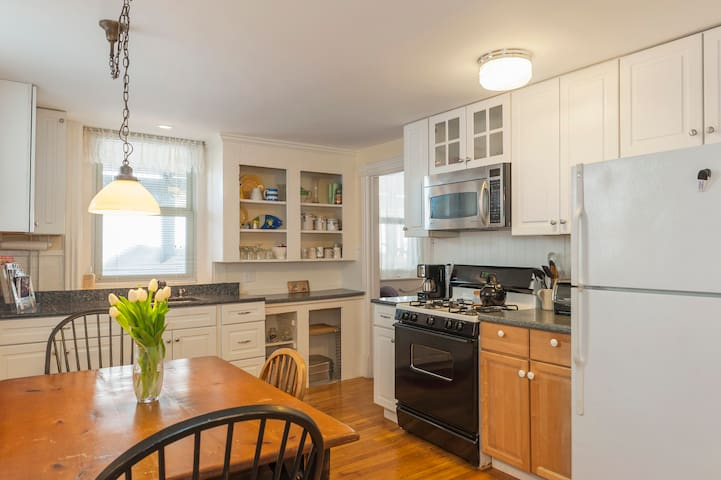 Airbnb Professional Photo Taken w/ wide angle lens. Rooms may appear larger.   Well equipped kitchen