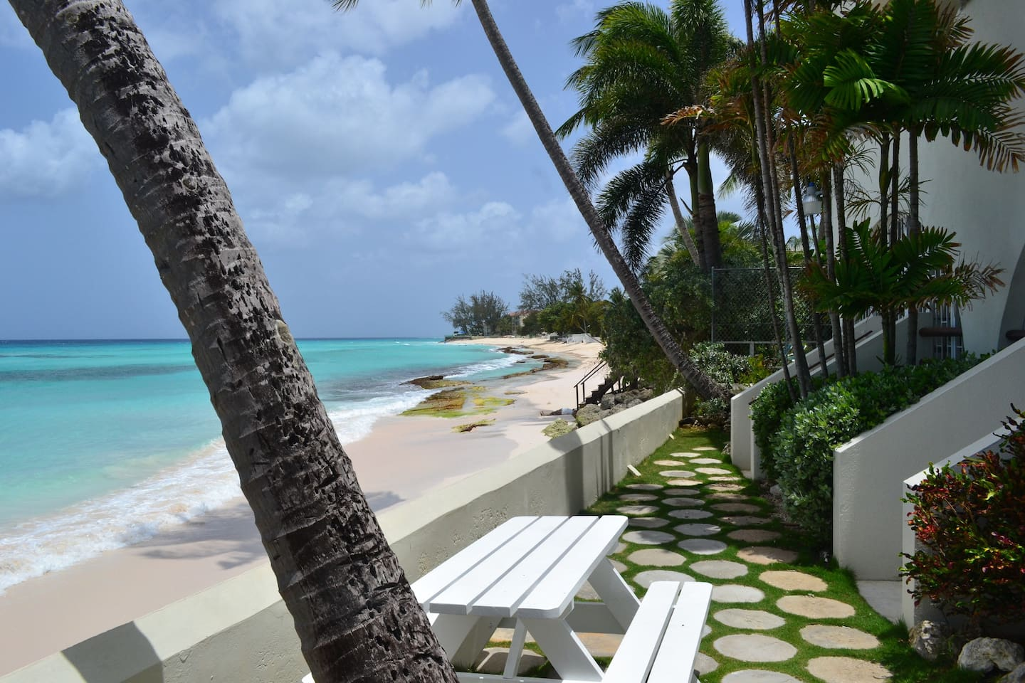 Patio steps on right leading down to deck and onto the Beach