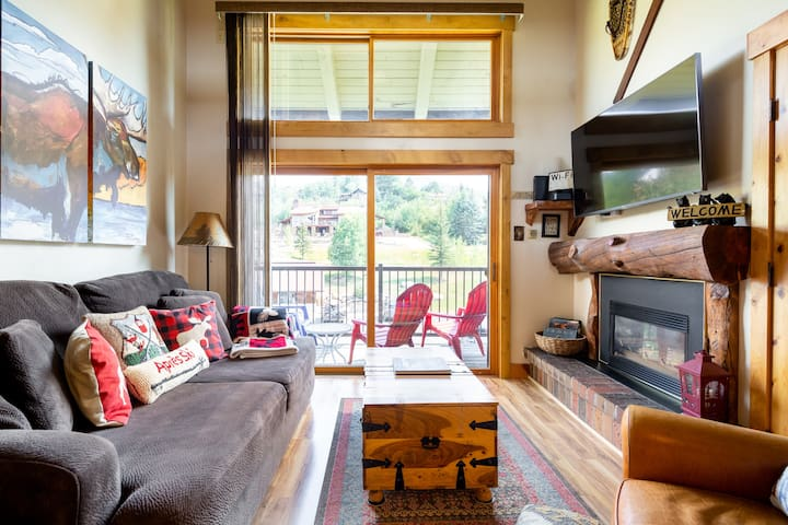 Living room with lots of natural light, gas fireplace, TV, DVD, select movies, games and cards!