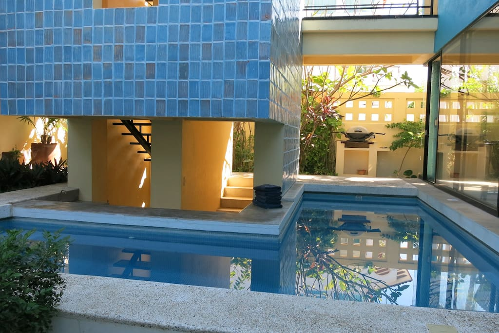 Pool wraps around two sides of tower staircase.