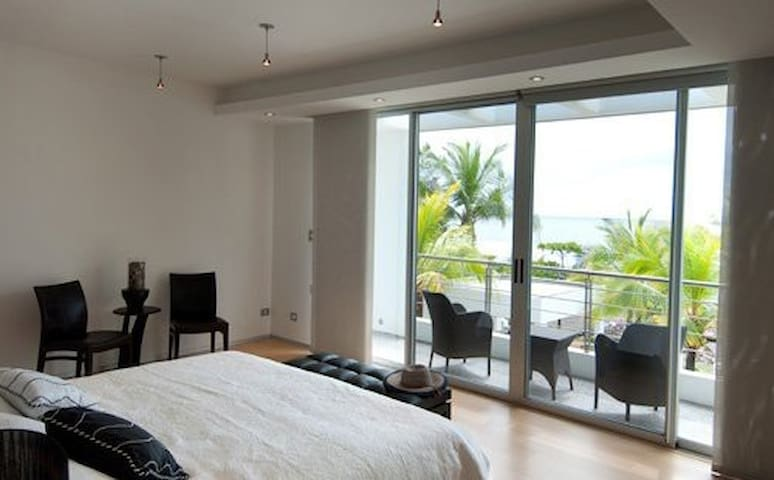 The master bedroom, with a balcony that provides an amazing view of the beach.