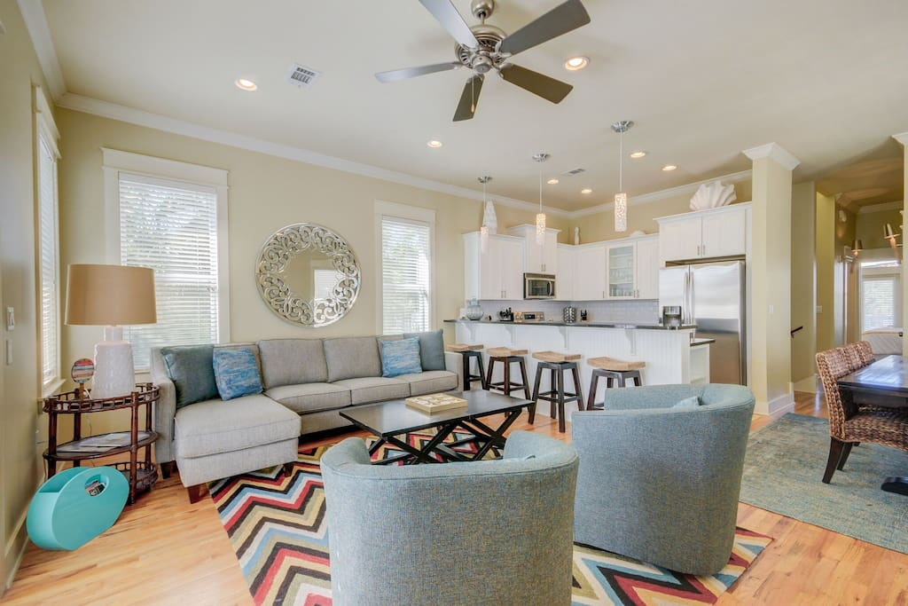 Open Concept Kitchen with 4 Counter Stools, Dining and Living Room