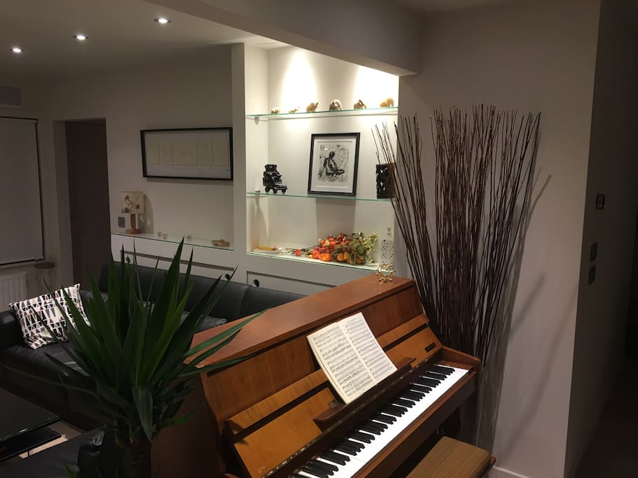Piano and L-shaped couch in Living room
