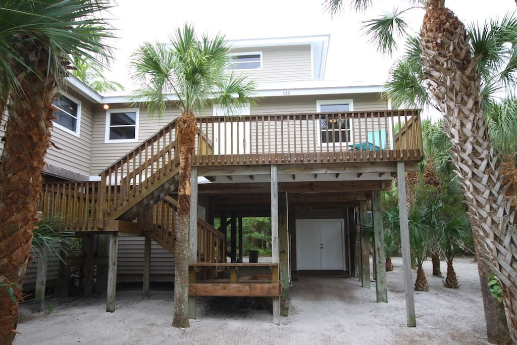Secluded in Palms and Coconut trees Front view second floor entrance