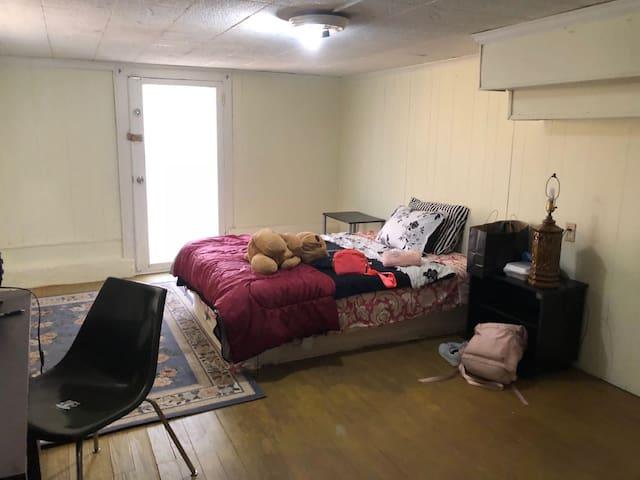B. by street car,Tulane university. basement room